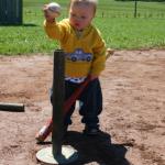 child playing t-ball